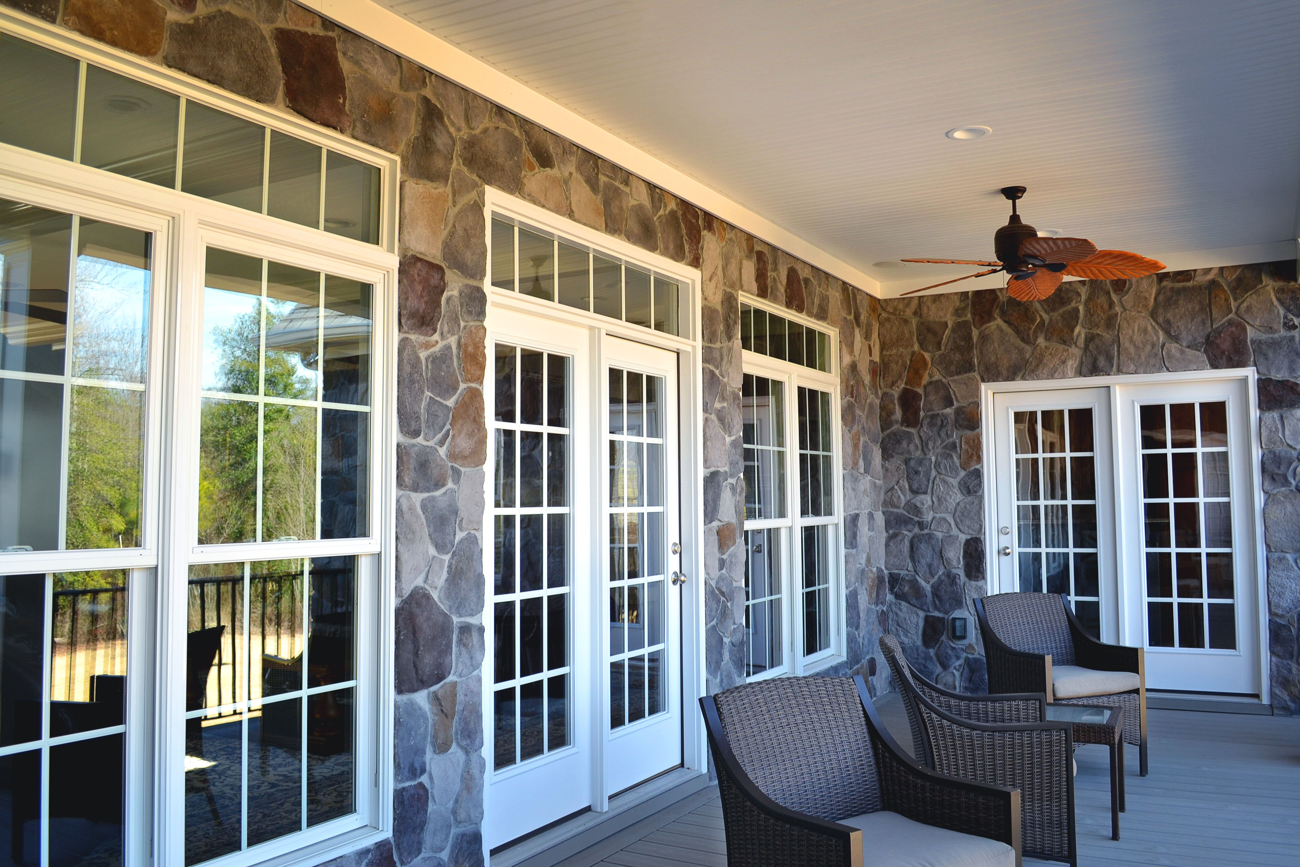 Patio On The Second Floor With Large Windows And French Doors Stone Siding C Balducci Exteriors Windows Exterior Large Windows