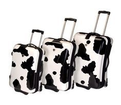 Cow print luggage  I WANT an adventure!!!