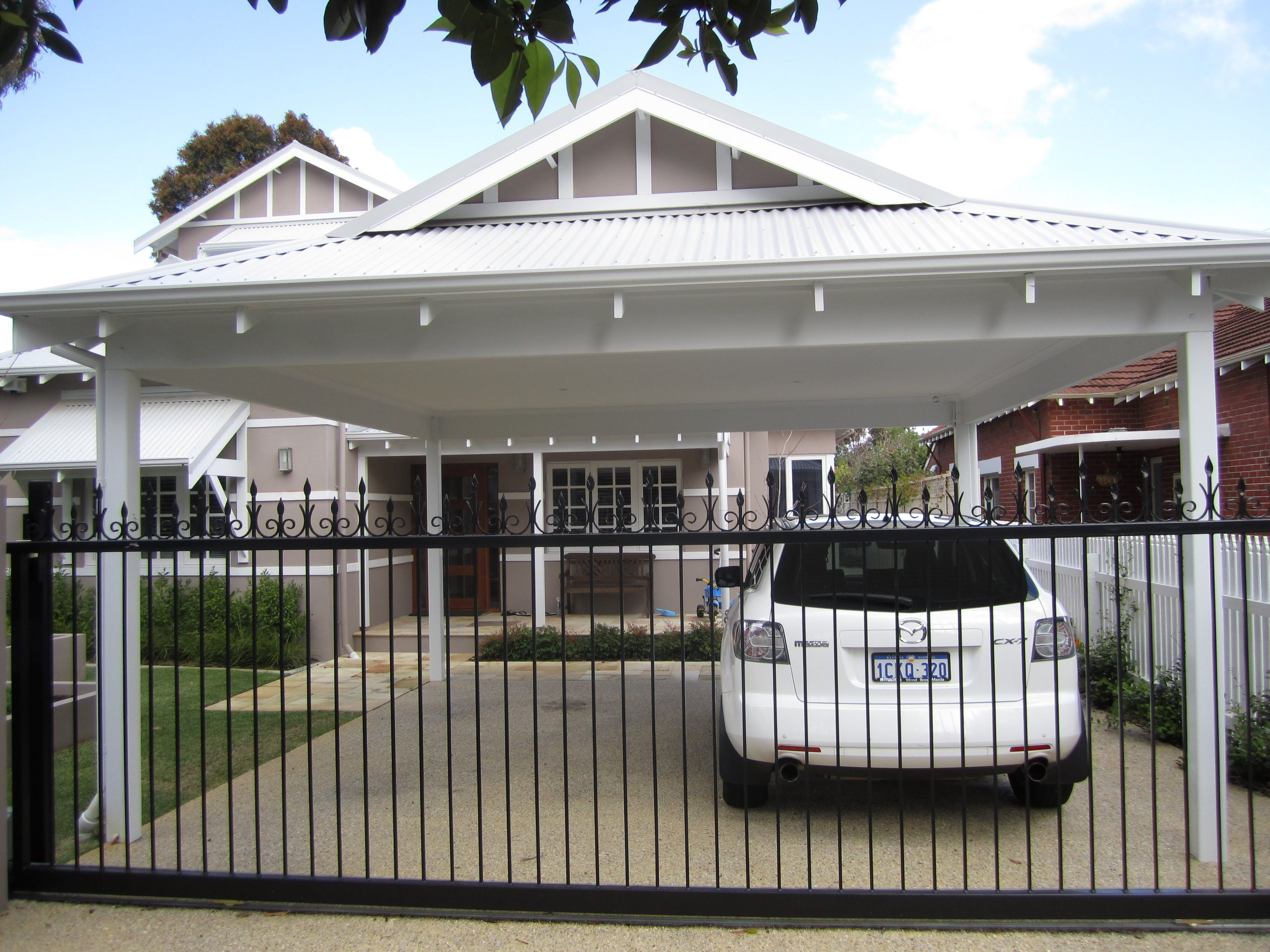 How To Build A Wooden Carport Off Your Existing Garage Carport Garage Garage Pergola Wooden Carports
