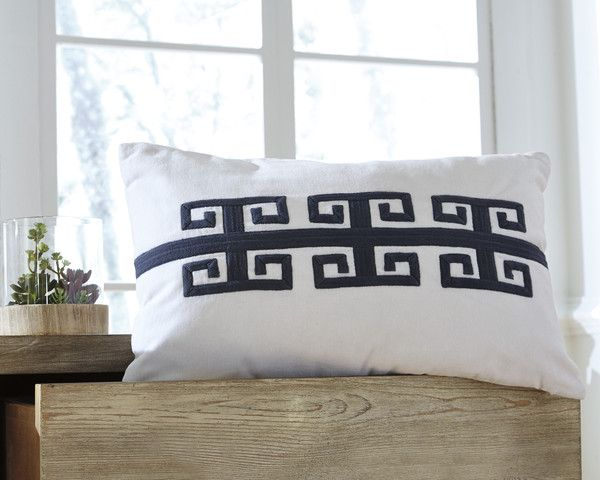 """This 22"""" x 14"""" cotton pillow features a contemporary navy pattern on the front."""