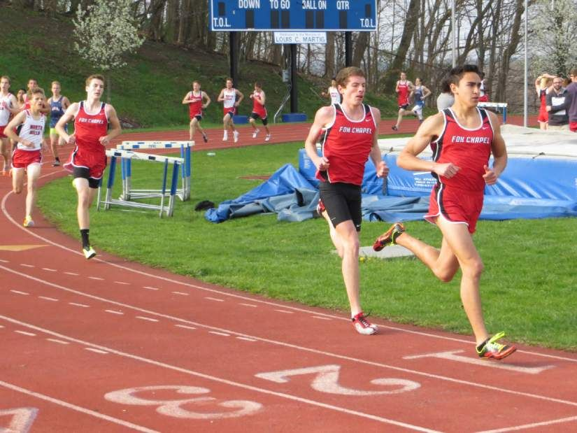 Elias Graca running with teammate Colin Martin.