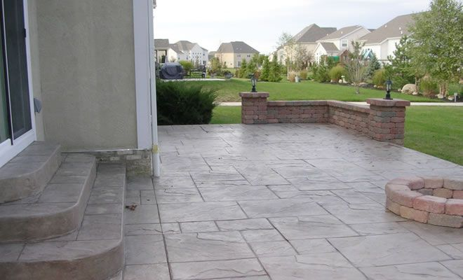 Stamped Concrete Patio And Concrete Paver Walls