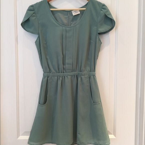 Pins and Needles Pintuck Dress Pins and Needles Pintuck Dress size medium. Mint green color.  Peep through back and front pockets. Lightly worn and in great condition. Pins & Needles Dresses Mini