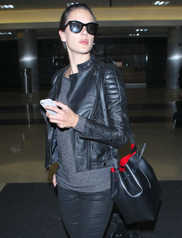 Airport Style The Many Bags Of Celebrities At Lax 1 Alessandra Ambrosio Mansur Gavriel Bucket Bag Although S Don T Have Any