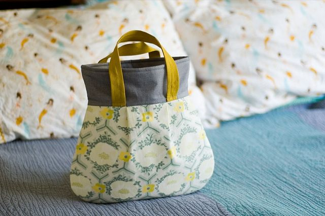 frenchy - a sample of Amy Butler's Frenchy pattern in the shoulder bag size.    Nani Iro Antique Label, Robert Kaufman Quilters Linen, Echino Solid and lined with an incredible Jane Sassaman yellow polka dot from Sunshine & Shadows...at the top of the bag the dots are really dense & then they sprinkle into an almost solid at the bottom of the bag.