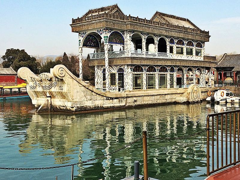 Chinese Architecture / Marble boat at Summer Palace. Beijing, China. The origins of the Summer Palace date back to the Jurchen-led Jin dynasty in 1153, when the fourth ruler, Wanyan Liang (r. 1150–1161), moved the Jin capital to Yanjing (present-day Beijing). To day's Summer Palace built in 1750, largely destroyed in the war of 1860 and restored on its original foundations in 1886.