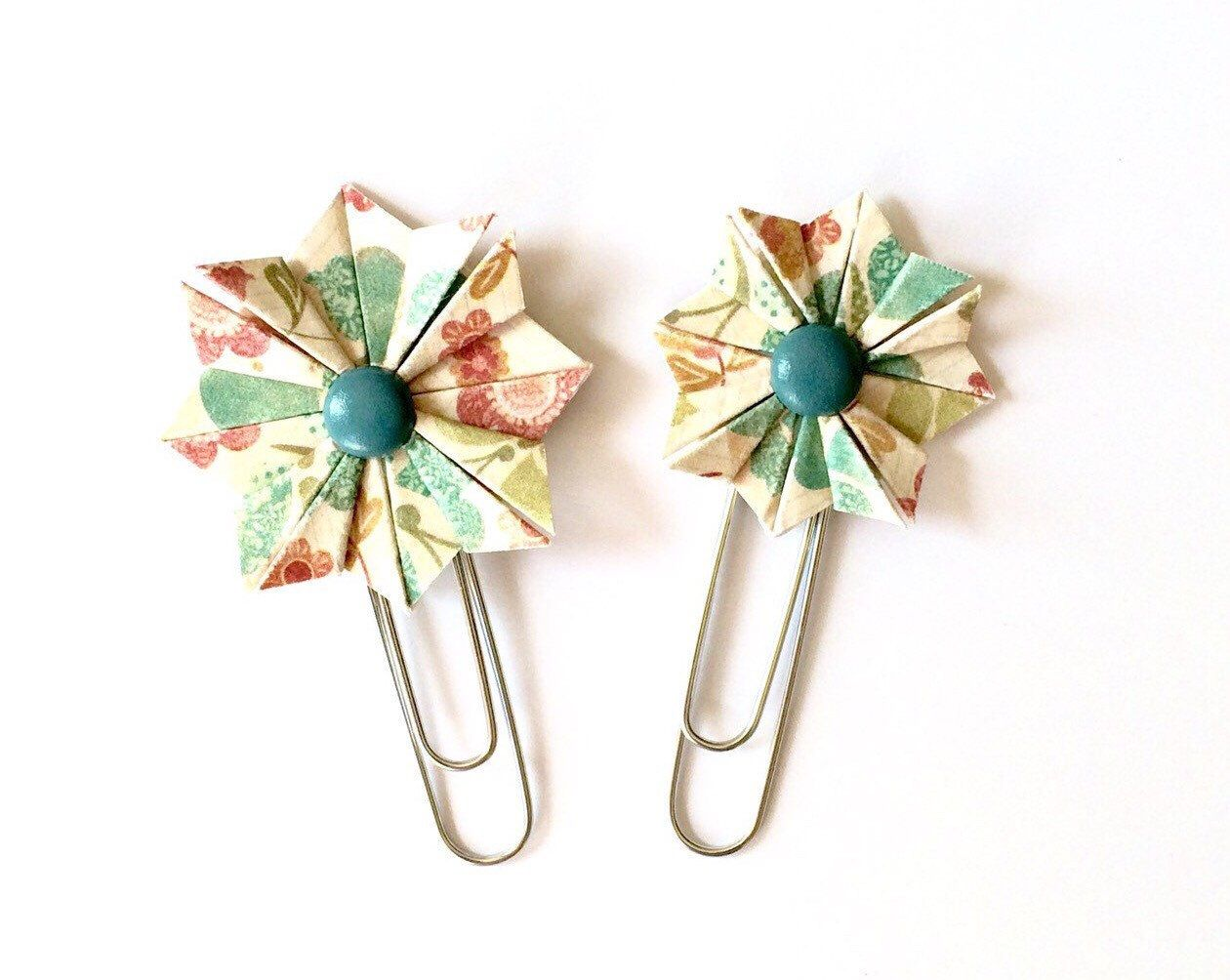 A personal favorite from my Etsy shop https://www.etsy.com/listing/222578907/planner-clips-filofax-bookmarks-origami