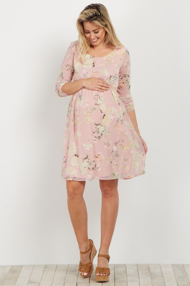 10a75d7523e A floral printed maternity dress. Rounded neckline. Chiffon. Double lined  to prevent sheerness. Cinched under bust. Roll tab 3 4 sleeves.