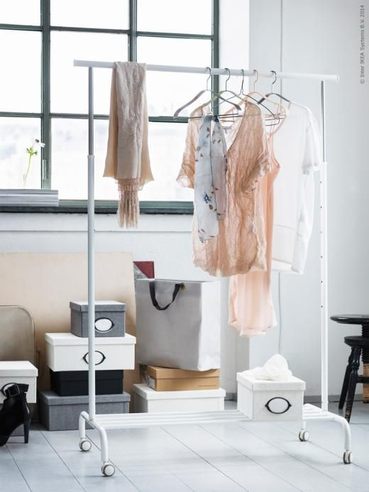 A rolling clothing rack  like RIGGA  is great for storing out of season  clothing. RIGGA Clothes rack  white   Laundry rooms  Laundry and Organizing