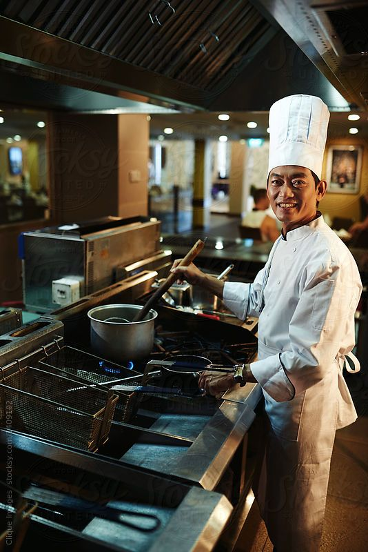 Young Smiling Chef Cooking Dish Asian Male Chief Cook Standing