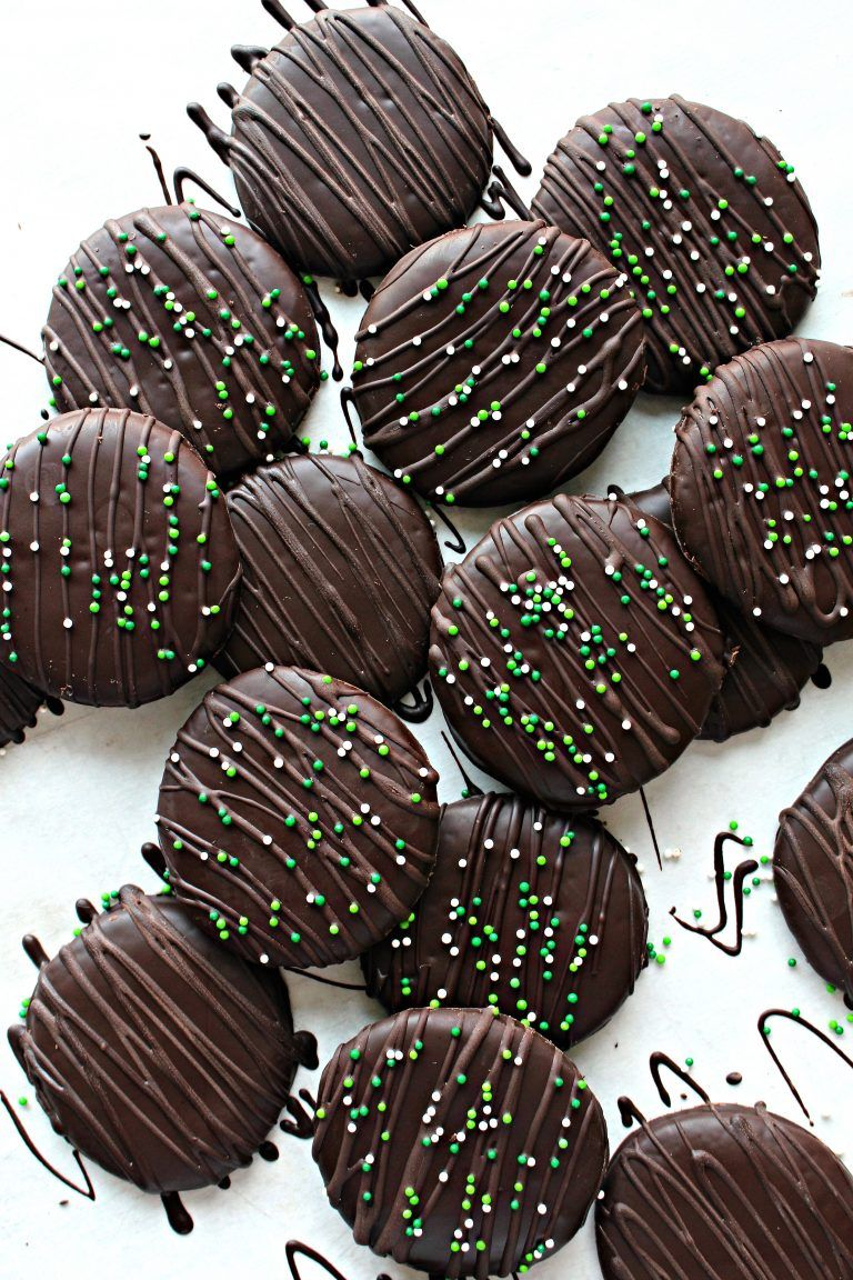 Chocolate Covered Chocolate Mint Cookies are crunchy, chocolaty, minty waffers dipped in creamy chocolate. An extra drizzle of chocolate on top and a few colorful sprinkles, make these cookies a festive treat for any occasion.  themondaybox.com #cookies #chocolatemint #chocolatemintcookies #girlscoutcookies #stpatricksday