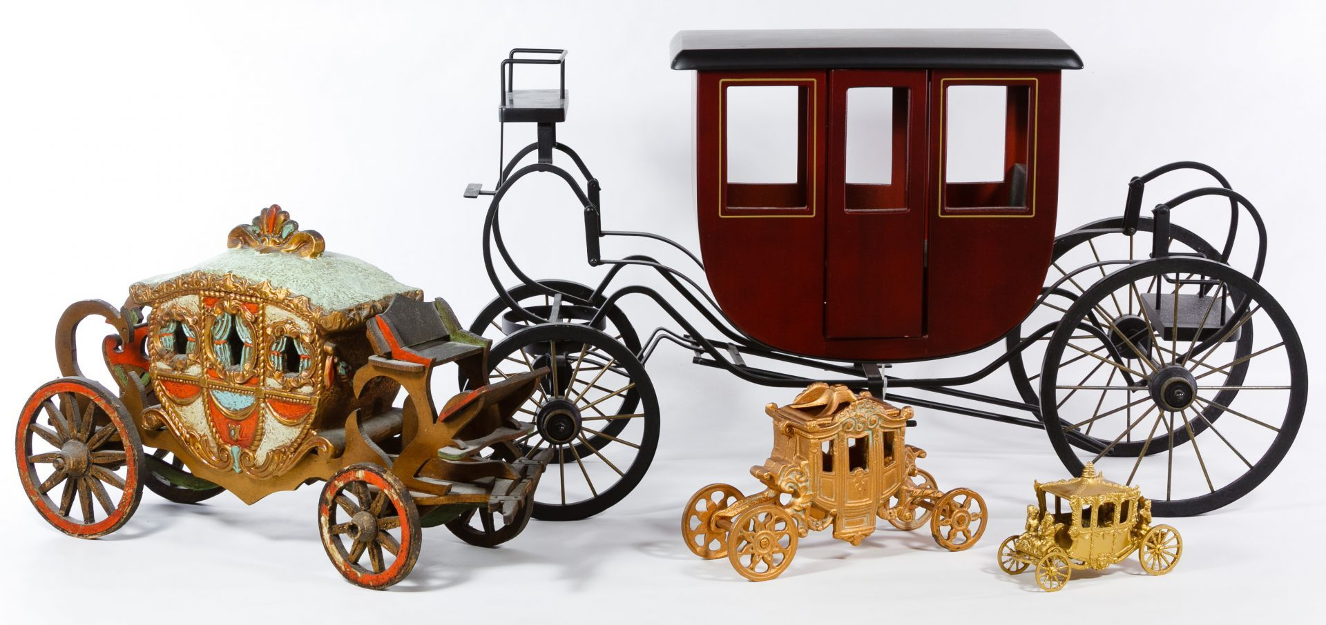 Lot 683: Toy Carriage Assortment; Four carriages including two gold cast metal carriages, wood carriage and metal with wood carriage dated 2001 from Byers Choice