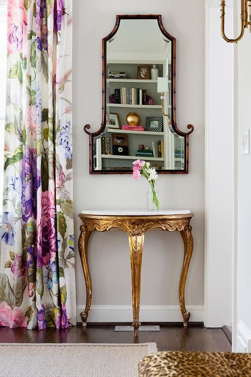 Chic Dining Room Boasts A Marble And Gold Leaf Half Moon Table Bamboo Mirror
