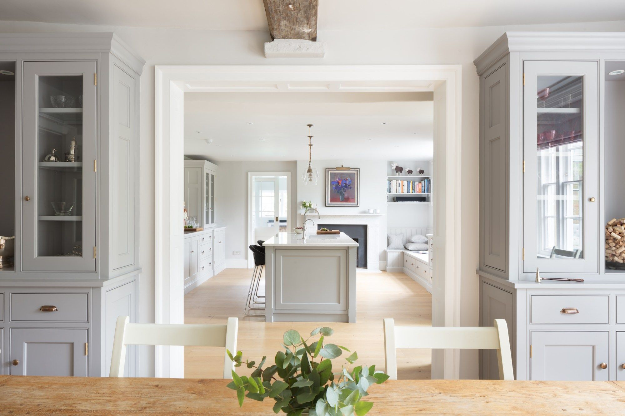 Instead of a totally open kitchen/dining room, perhaps we open up a ...