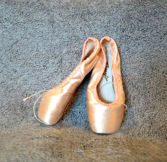 I always wanted to go to ballet classes but Mum said I wouldn't like them. I think now that the real reason was that we couldn't afford them. I read lots of fiction and non fiction ballet books and set up a ballet school in my dolls house instead.  Vintage Ballet Slippers Size 5 Ballet Makers USA Capegio