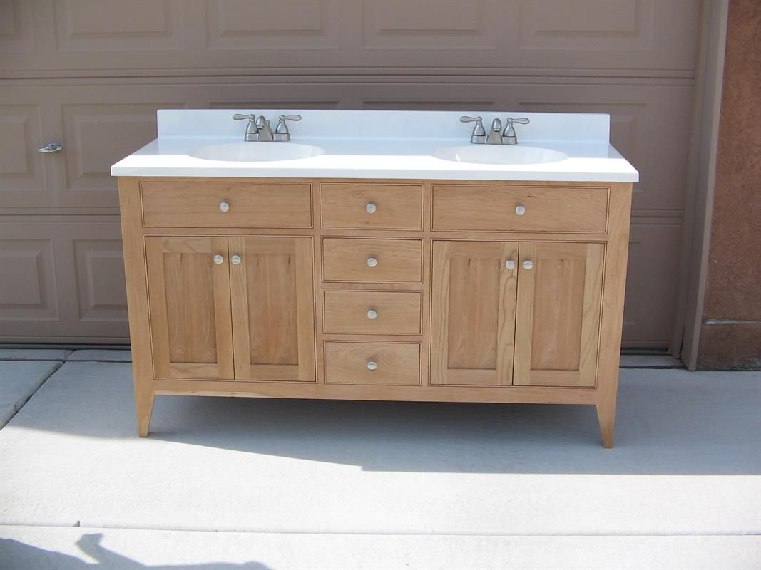 Shaker Style Cherry Tall Bath Vanity With A 2 Sink Top. The Cabinet Has 4  Centrally Located Drawers. There Are 2 False Drawer Fronts And Double Doors  On ...