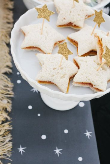 """Star-Shaped Sandwiches: """"For the girls, I made little star peanut butter and jelly sandwiches with a cookie cutter,"""" Kirsten says. """"I also added star toppers."""" Source: 6th Street Design School"""