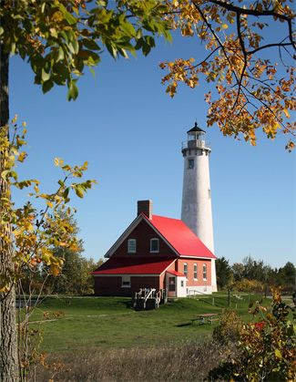 Tawas Point Lighthouse, located in Tawas Point State Park, on the spit east of Tawas City, Michigan--LHF-history