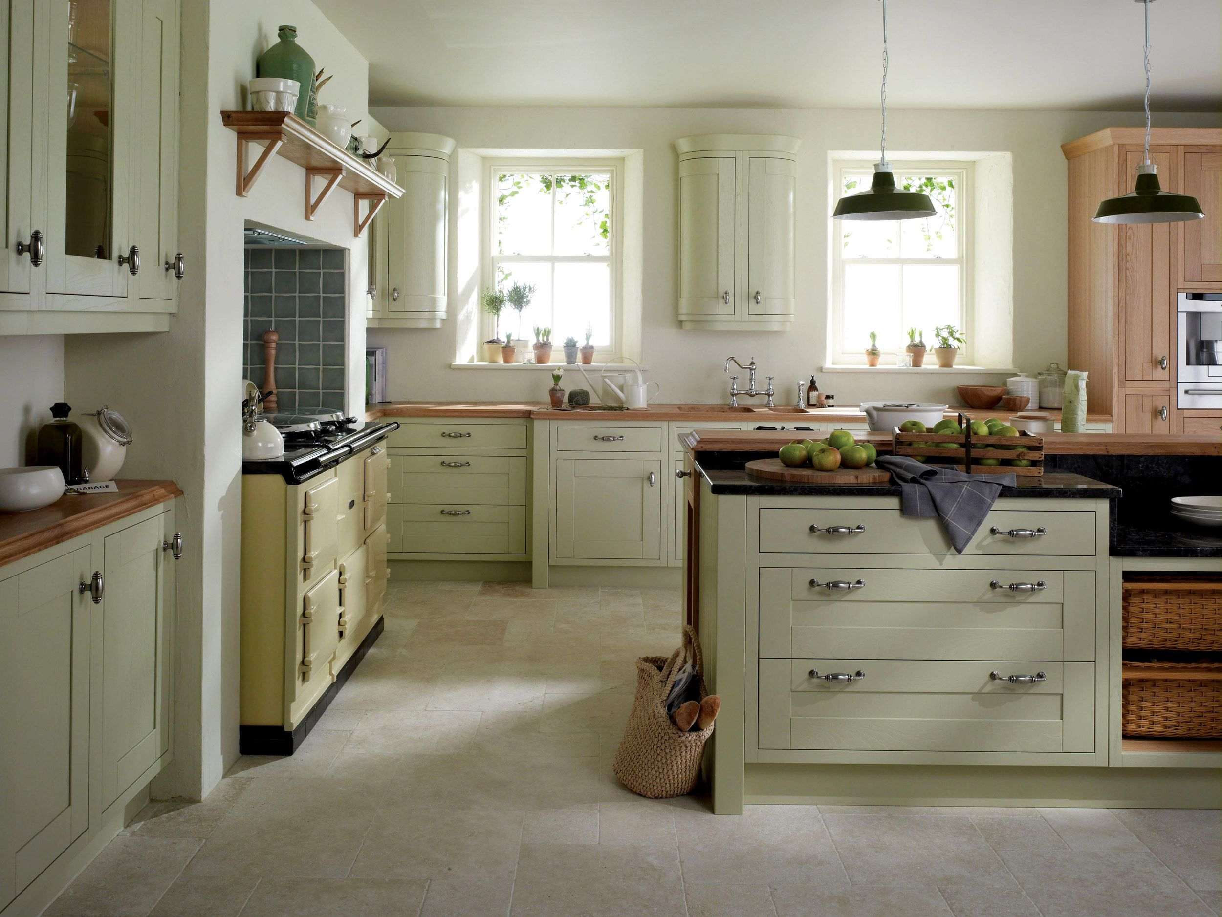 Interesting Country Kitchen Idea With Soft Green Cabinets And Island Color And Black Granit Green Kitchen Cabinets Kitchen Design Small Country Kitchen Designs