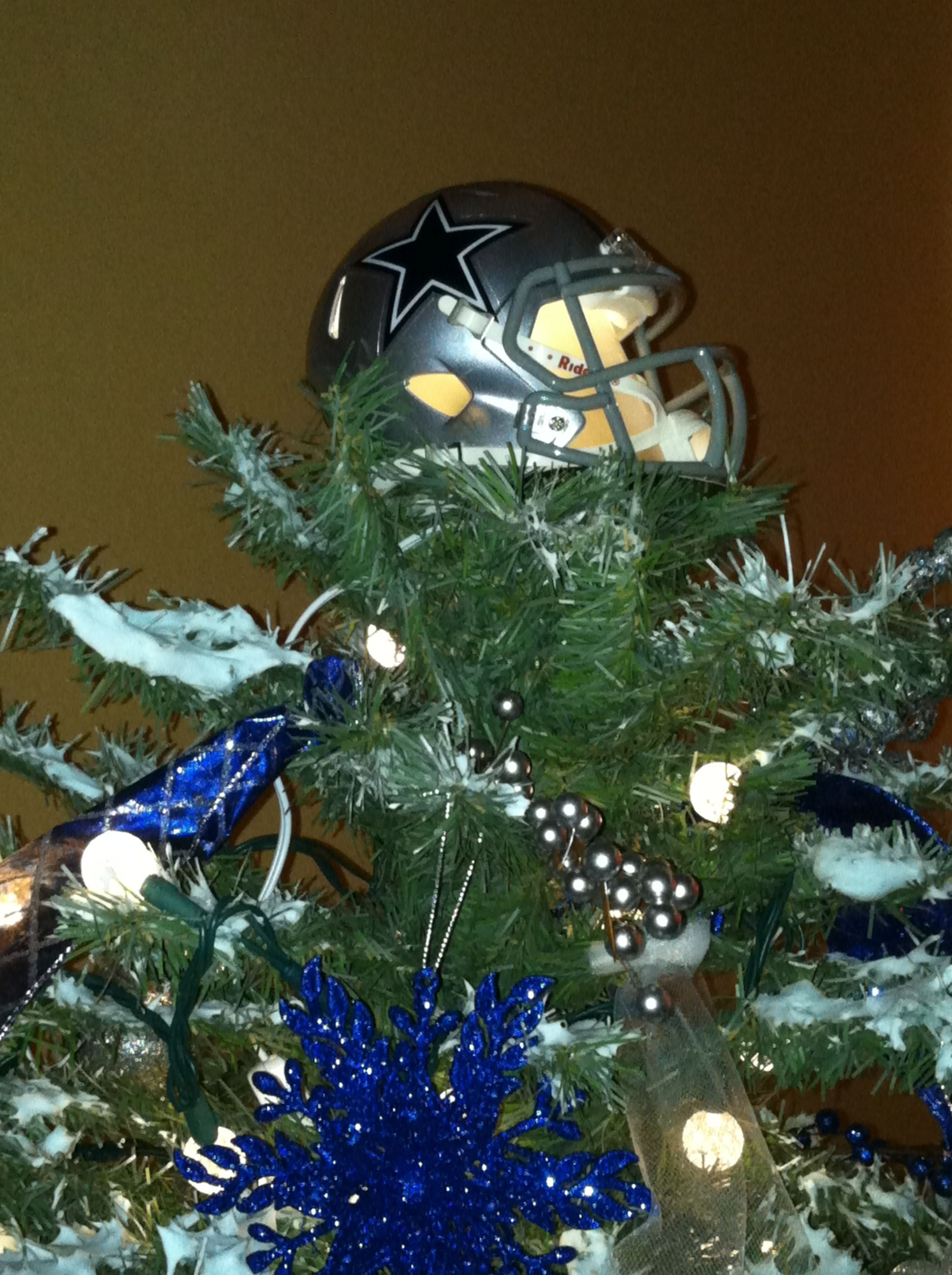 Dallas Cowboy Christmas tree topper...took a mini helmet ...