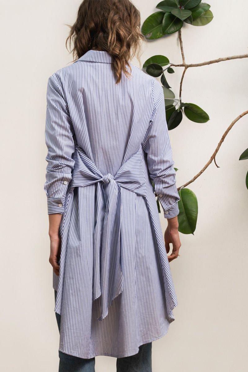 f81f7e6a401 Pinstripe Cotton shirt dress with volume and high-and-low bottom hem. Tie  detailing at back. Pinstripe dress. Pinstripe shirt. White and blue stripe  dress.