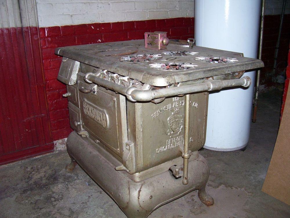 Vintage peninsular stove 1900 era gas/coal cast iron pick-up detroit
