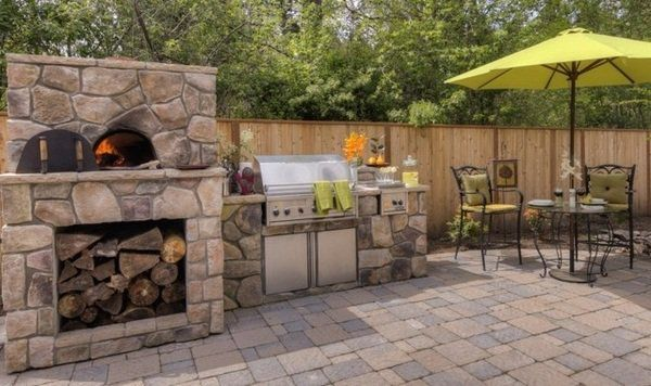 small patio deck design stone fireplace with pizza oven grill area