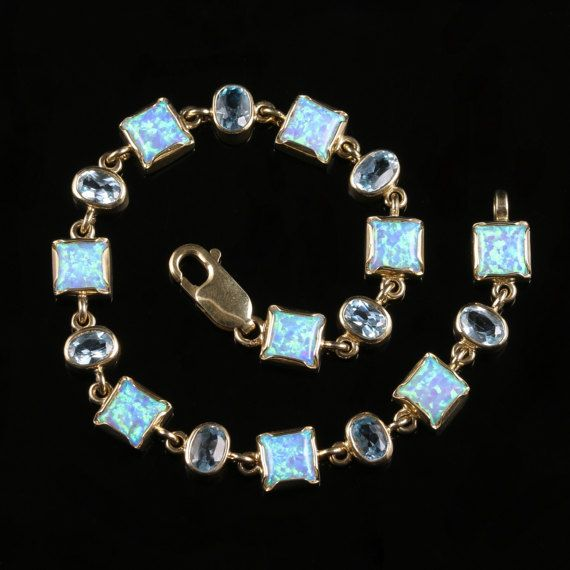 Opal and Blue Topaz Bracelet 9ct Gold Over 10ct of Stones