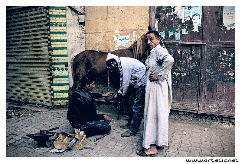 Blacksmith in the streets of Cairo - December 2013