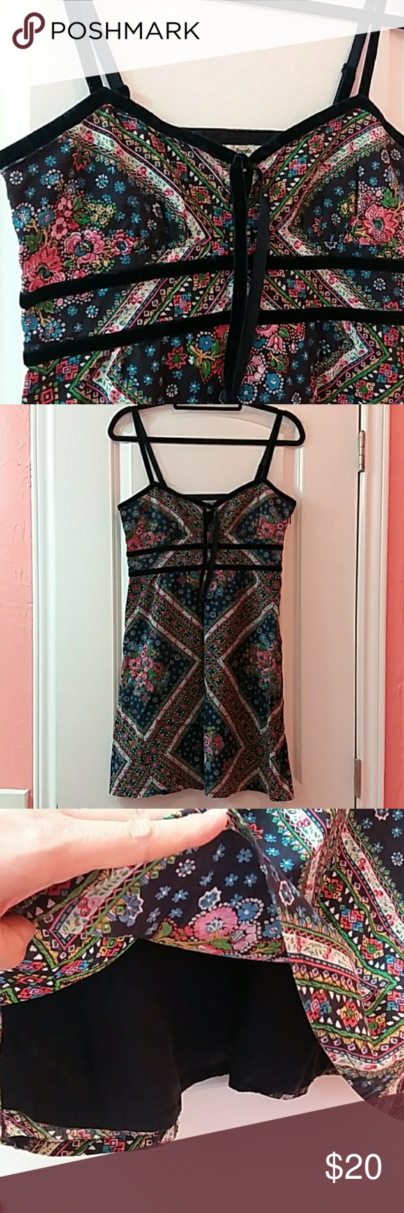 Free People Floral Print Short Sundress Super cute sundress from Free People. Trim and adjustable straps in navy valour ribbon. Beautiful, lightweight floral bandana- style print. Fully lined with lightweigjt navy fabric. Side zip. Excellent condition.  Measurements, laying flat and across the front only: Bust, pit to pit - 17.5 Empire waist, at velvet ribbons - 15 Length, from neckline to hem - 27 Free People Dresses Mini #shortsundress