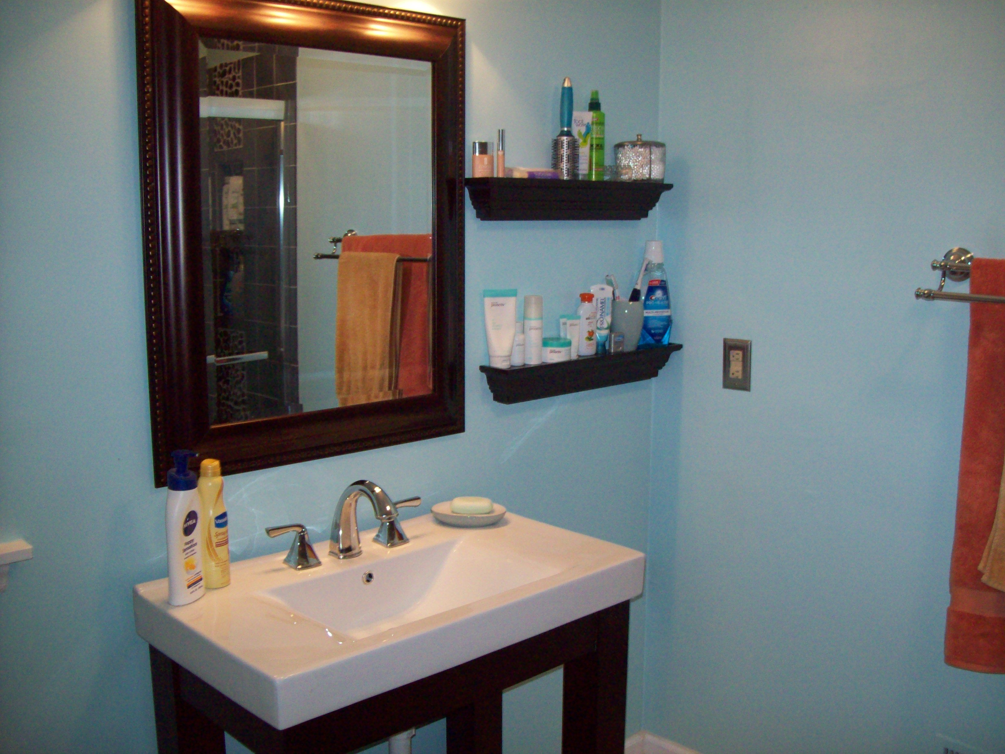After: Fresh blue paint, modern sink, and shelves to replace the ...