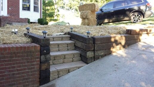 Railroad tie retaining wall with stone steps and solar ...