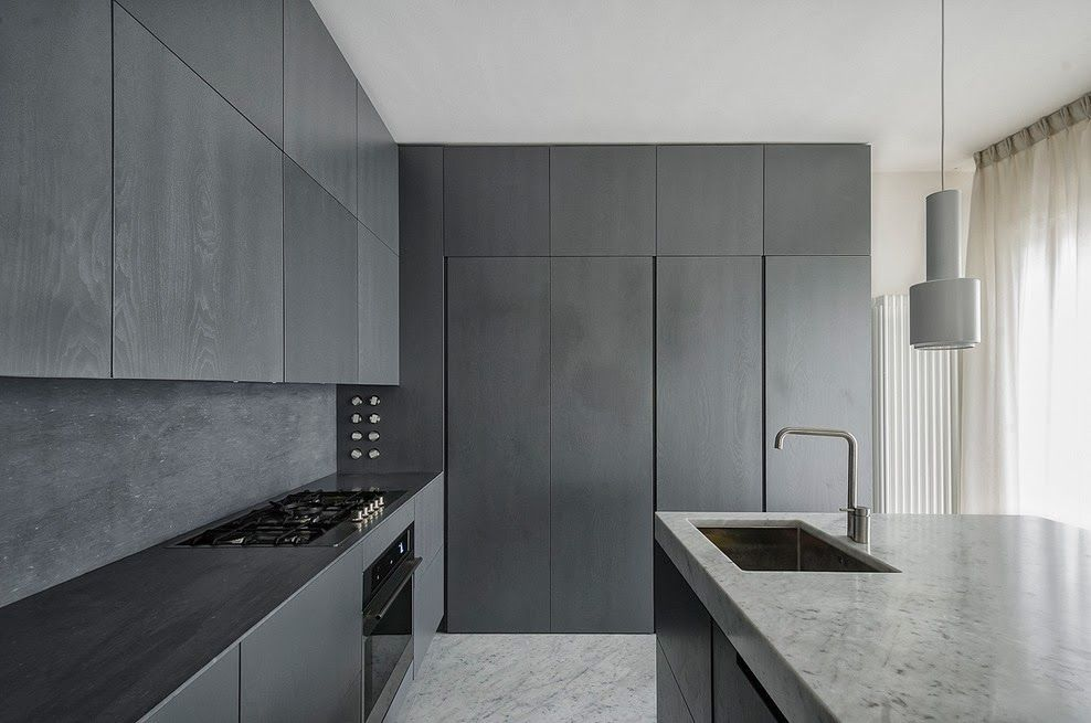 Like black tall cabinets and sleek bench top contrasted with thicker marble on island