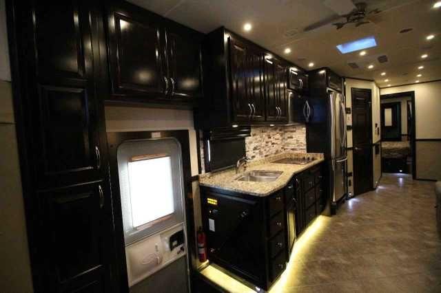 2016 Used Show Hauler Motorhome Class C In Texas Tx Recreational Vehicle Rv 2016 Show Hauler Motorhome 2 Year Sho Tv In Bedroom Rv Interior Grey Upholstery