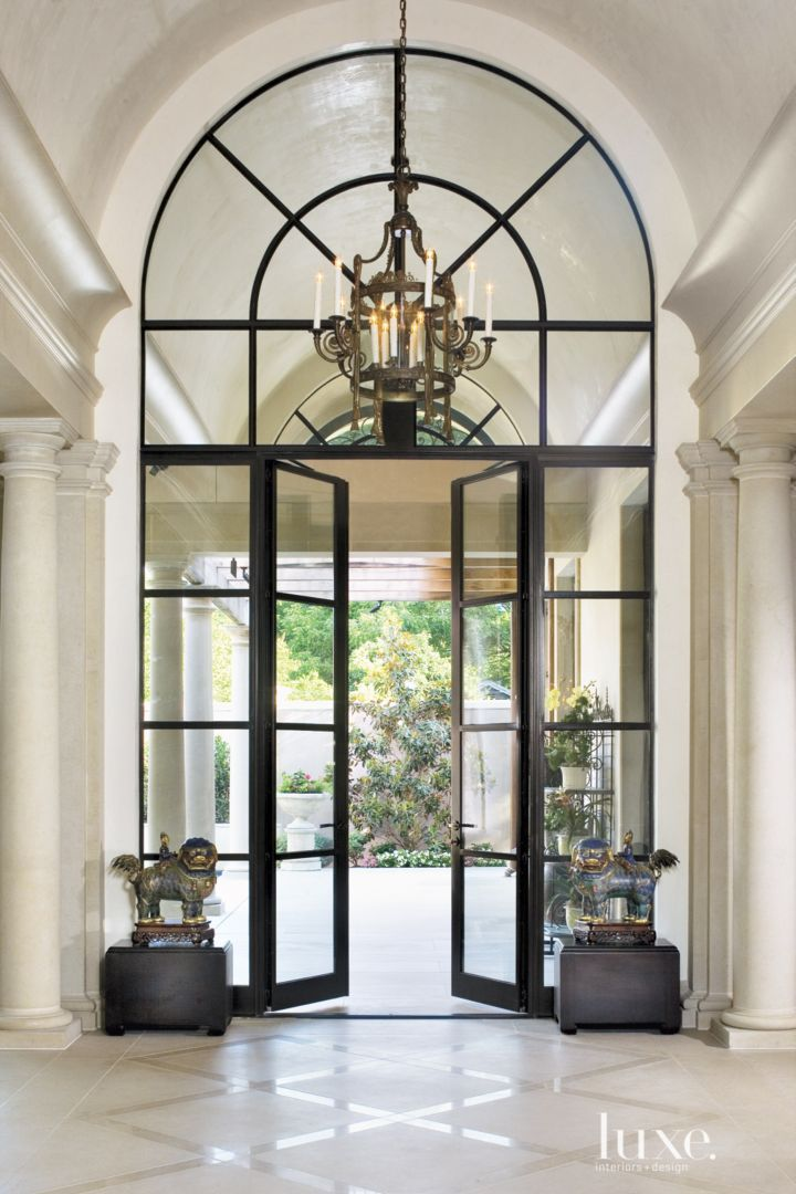 Barrel Ceiling At Foyer Leads The Eye To Steel Framed Glass Doors