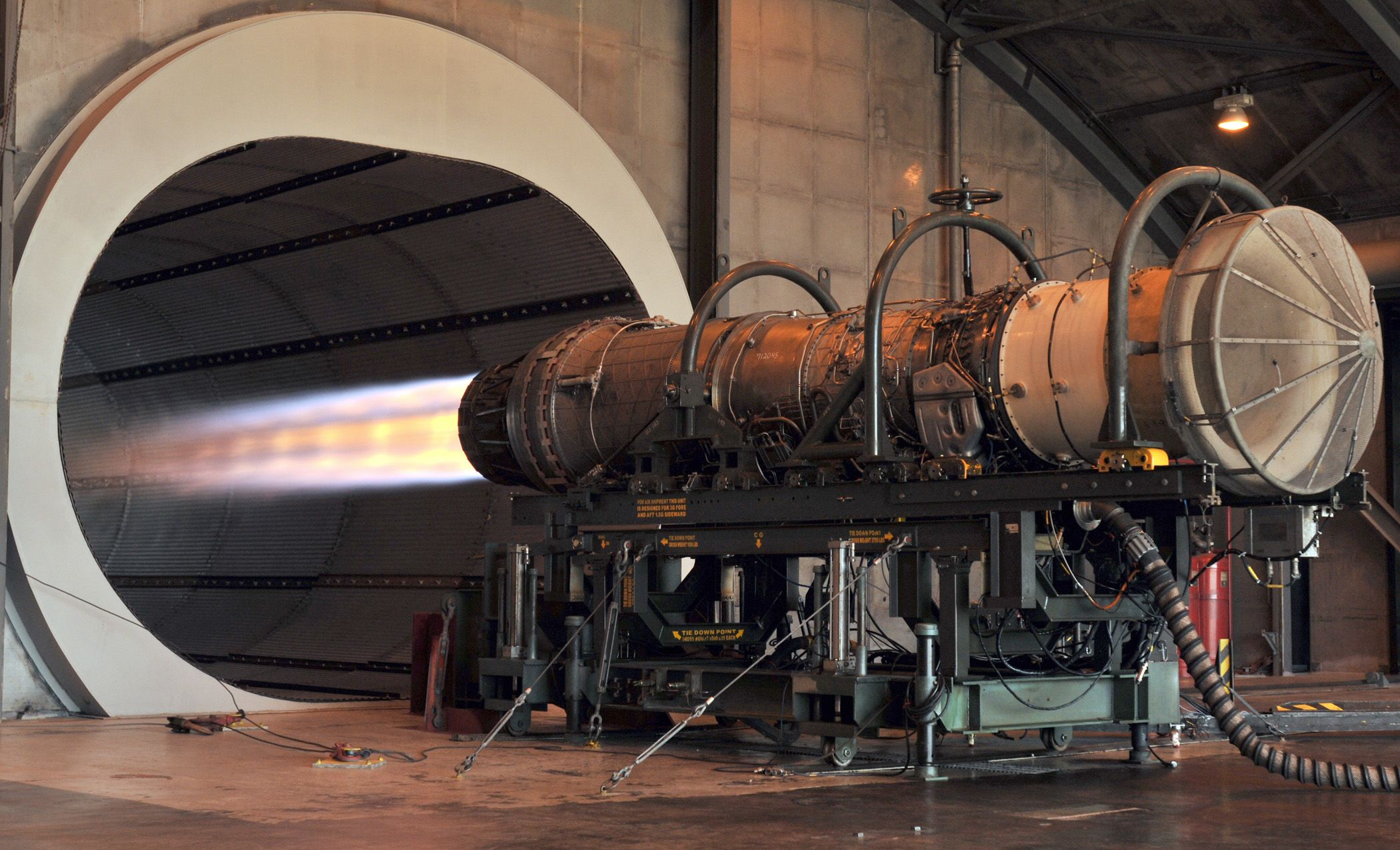 A Pratt & Whitney F100 turbofan engine for the F-15 Eagle being tested in the hush house at Florida Air National Guard base.