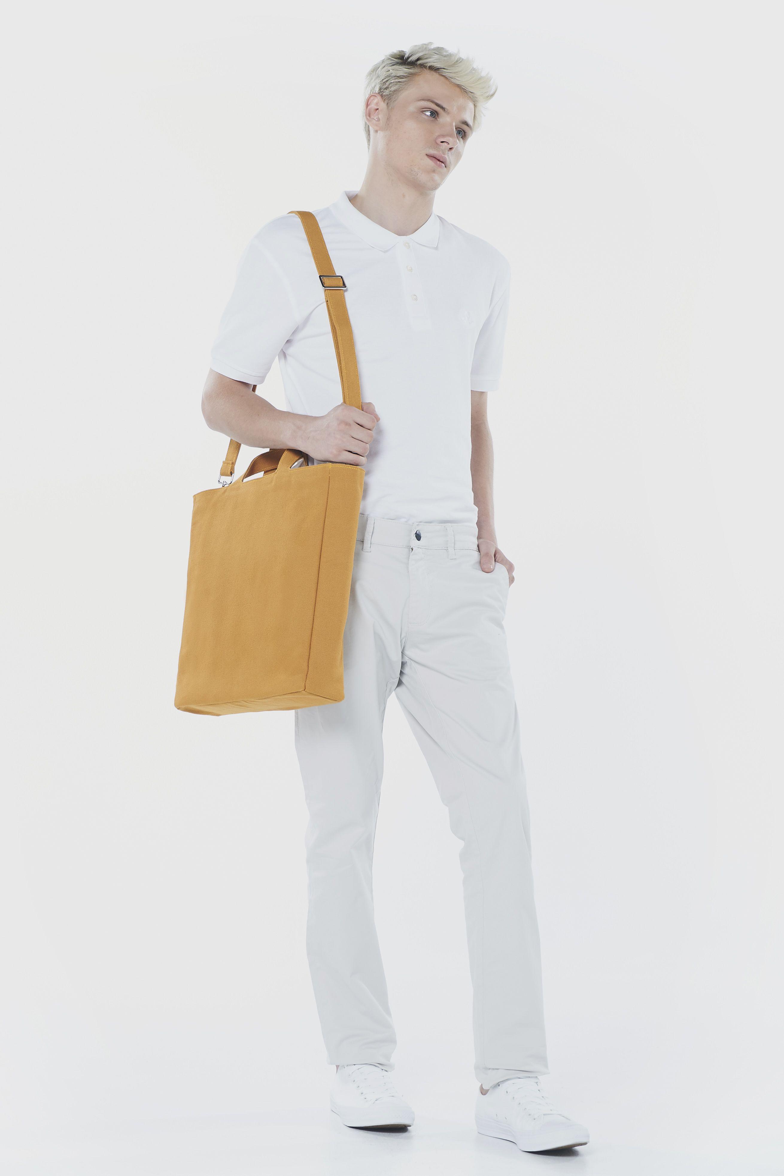 'Mag bag' is a tote bag which could adjust the shoulder strap. The shopping bag is an inspiration of design. All of the bag body is the one piece of the material it is so fascinating because the bag body is the same piece of the holder. It is easy to use in every occasion.
