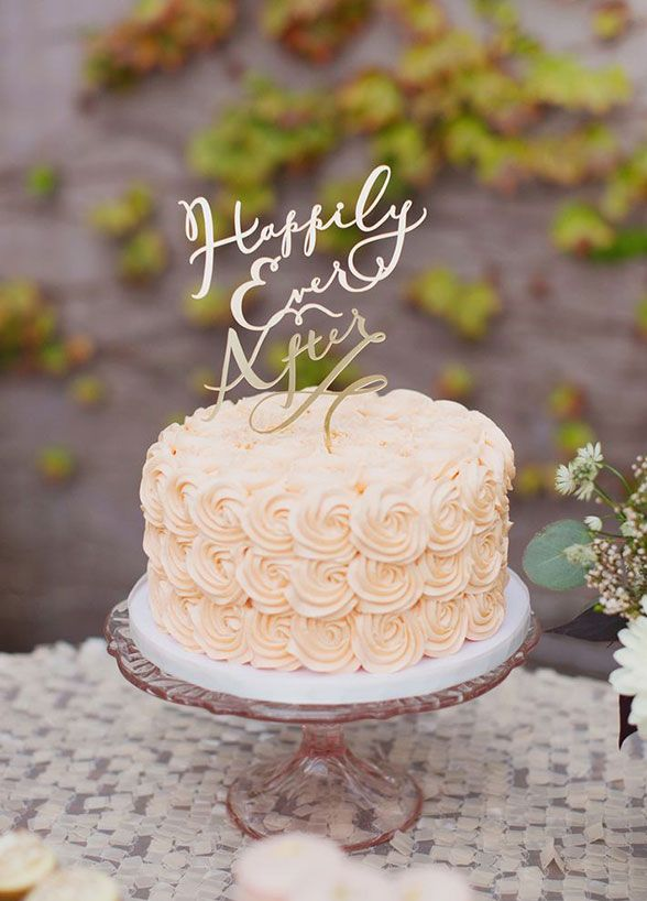 A sweet sentiment or phrase makes for an adorable cake topper. Bonus points for customizing your saying with your wedding colors.
