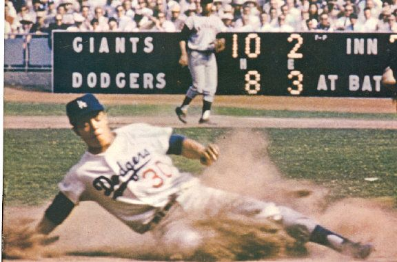 Maury Wills steals a Major League record 104 bases in 1962, on his way to being National League MVP.