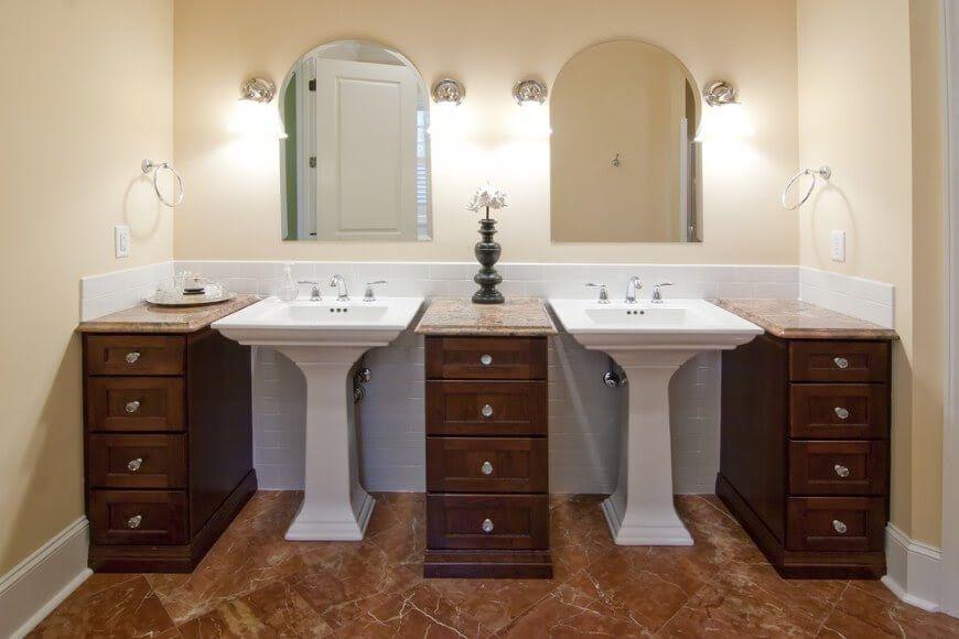 Bathroom With Pedestal Sinks And Free Standing Vanities