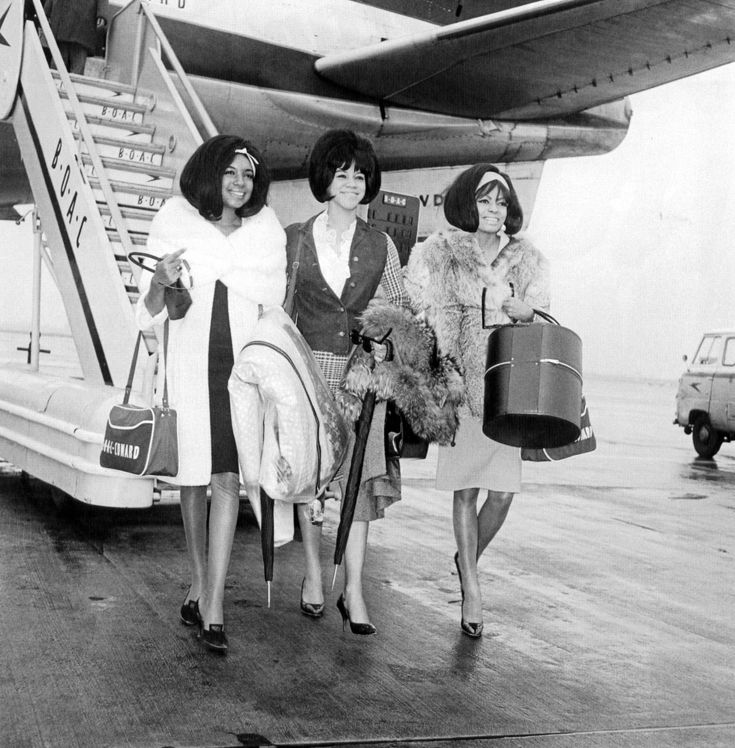 The Supremes with bags in tow, fly B O A C , which is now