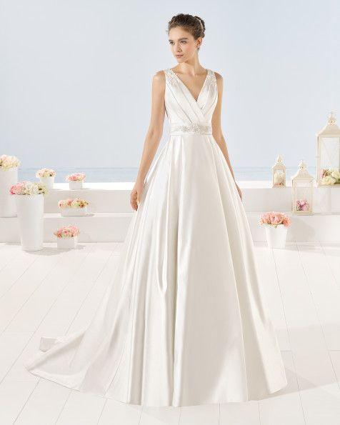 Vestido de raso y pedreria, en color natural y blanco.Vestido de ...