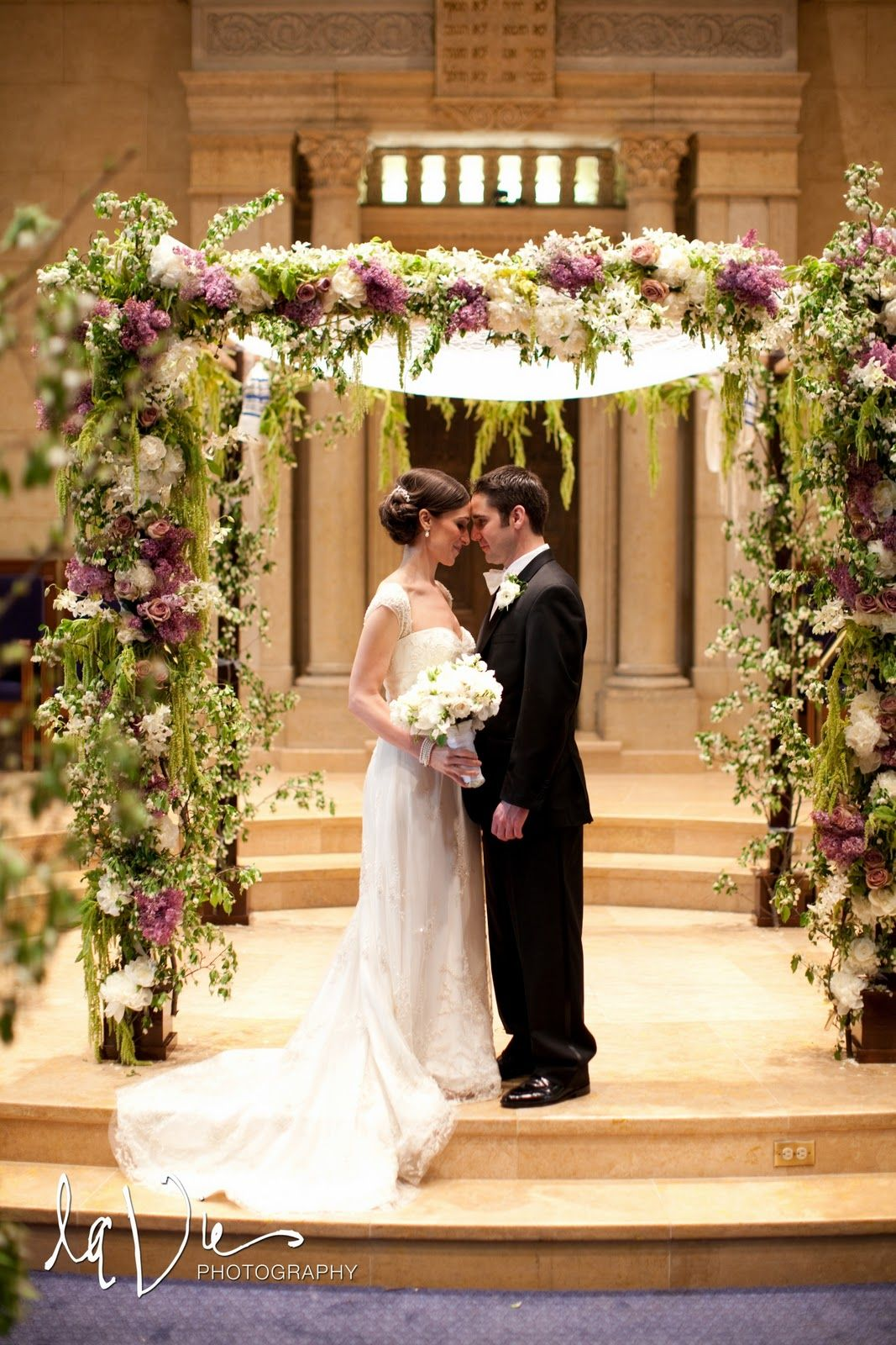 cocoa & fig lilac wedding- The flowers might be a little expensive, unless you want to go with silk. But it'd be a nice way of bringing the outdoors in.