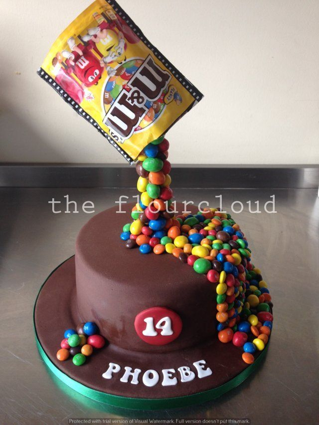 Pouring chocolate MMs onto this birthday cake Celebration Cakes
