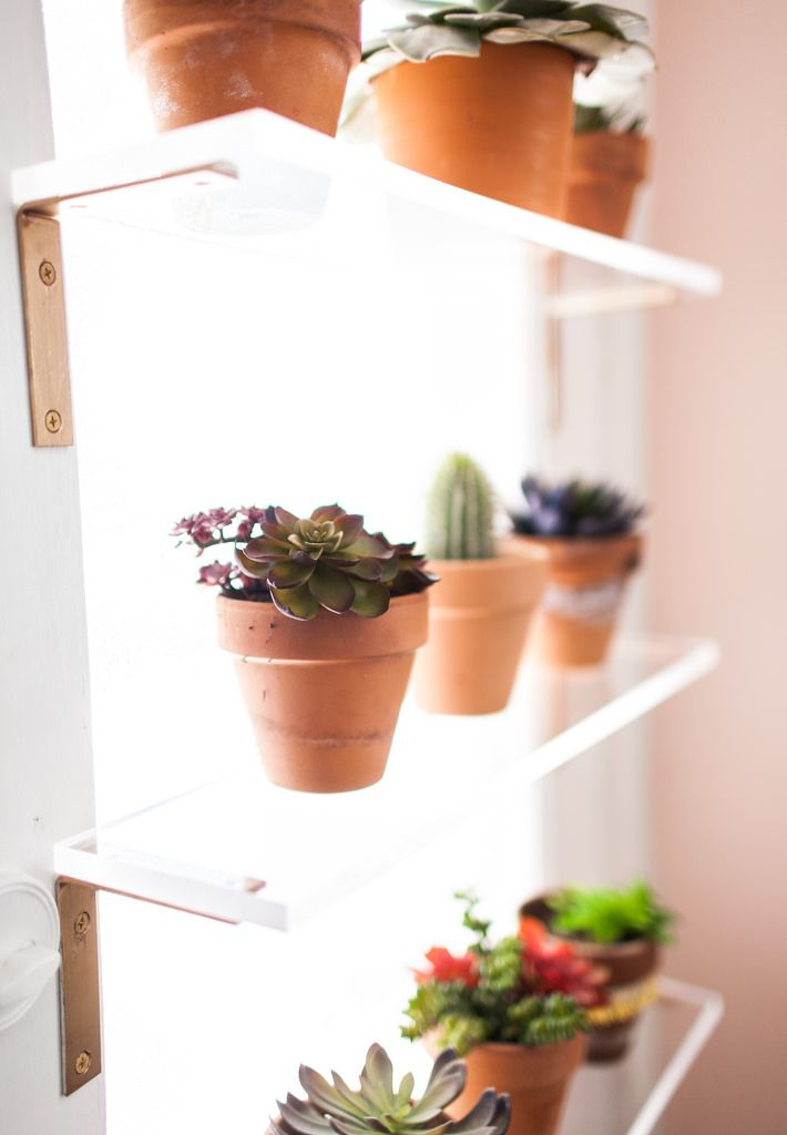 Simple Spray Painted Brackets And Plexi Glass Shelves In A