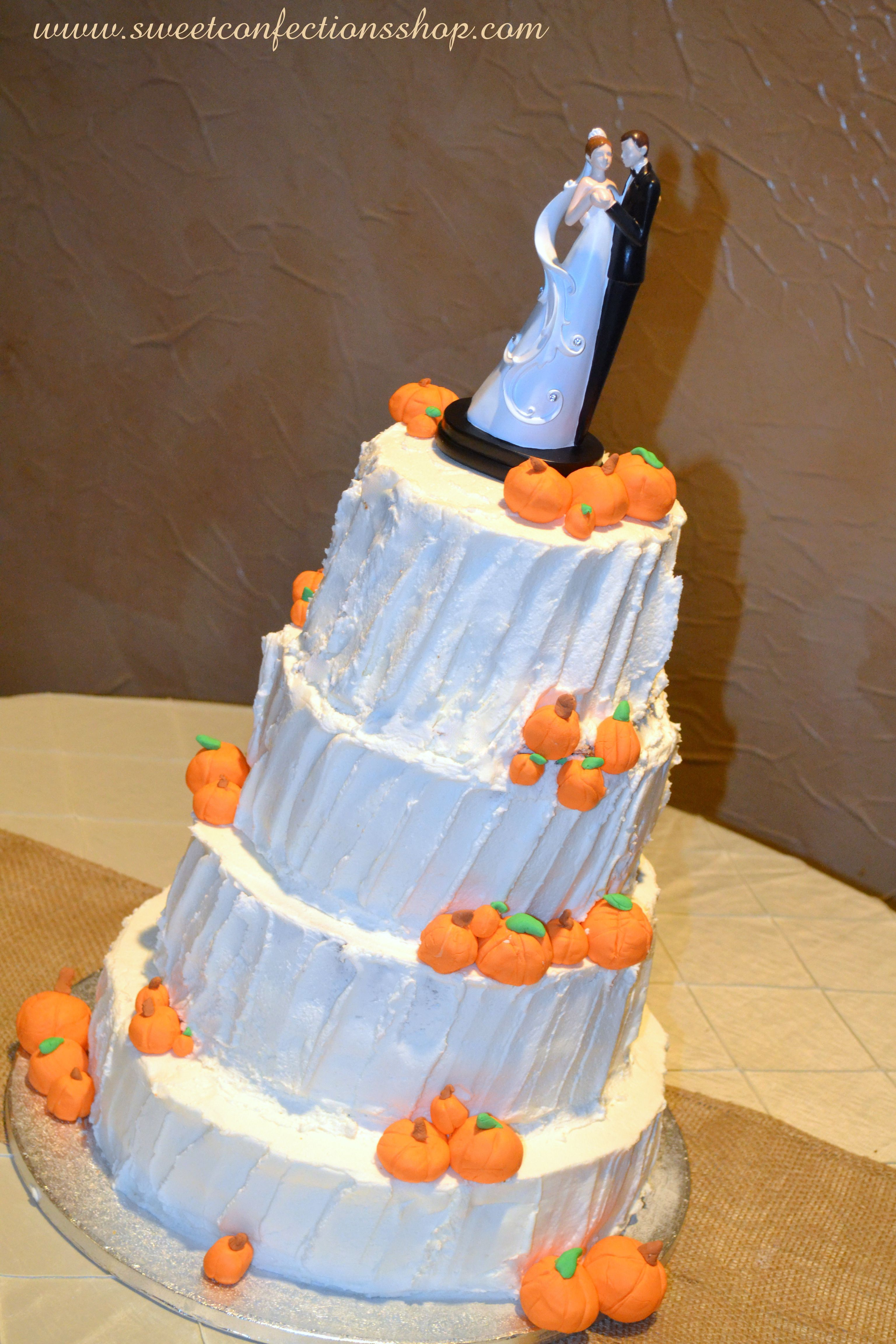 Pumpkin wedding cake.  This has fondant and chocolate pumpkins.  The icing is textured butter cream