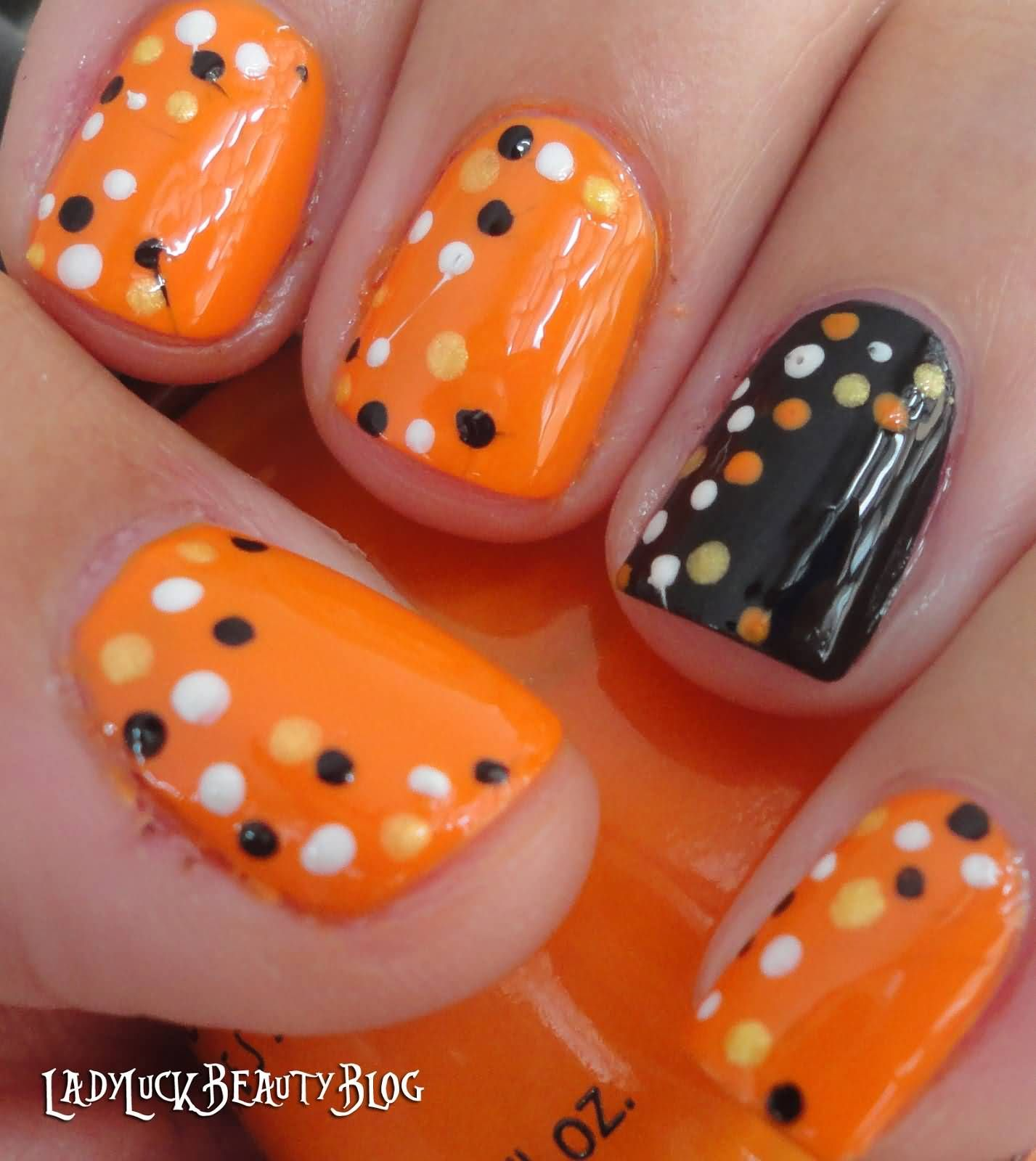 Orange base nails with white black and yellow dots design nail art