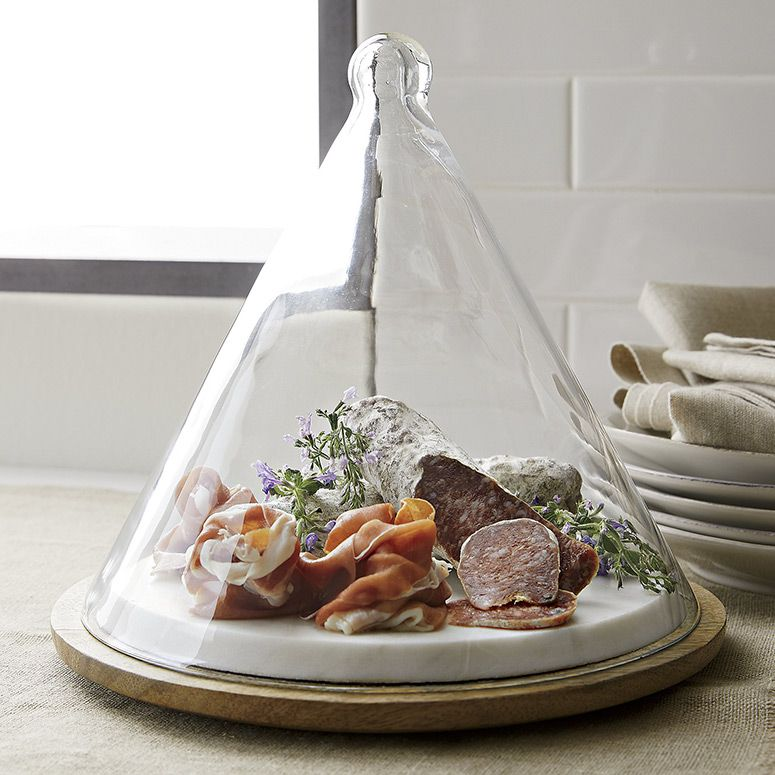 Coneshaped glass dome covered server crate and barrel