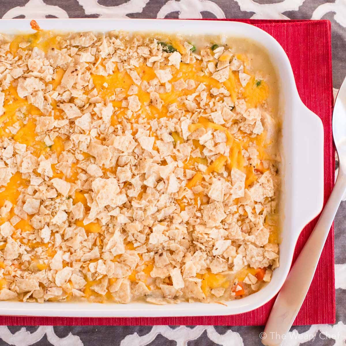 This chicken and vegetable quinoa casserole is loaded with tender chunks of chicken and cheddar cheese, then topped with crunchy tortilla chips. Such a satisfying and easy dinner recipe!