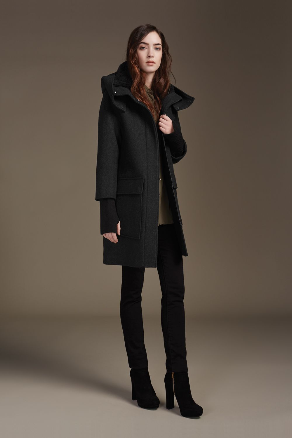 KERRIANE is a mid-length wool parka with oversize hood. Signature Sherpa lining at collar, quilted lining at bodice, and elongated ribbed cuffs with thumbholes provide extra warmth. Accented with a high-low hem and dropped shoulders, making this style the perfect effortless must-have. Discover at http://www.soiakyo.com/ca/en/kerriane-mid-length-wool-parka-with-hood-in-black-for-women